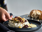 Baked camembert with grapes and walnuts