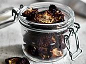 Plum chips: dried plums in a glass jar