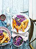 Crispy cod fingers with wedges and dill slaw