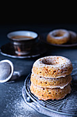 Baked carrot donuts with icing in dark mood