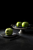 Three green Granny Smith apples