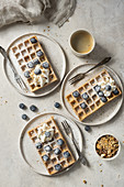 Gluten-free waffles with blueberries and whipped cream