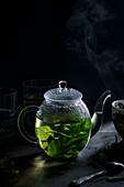 Fresh mint tea in a teapot
