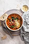 Italian ribollita soup with tomatoes, garlic, beans, spinach and thyme