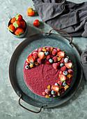 Vegan raw cheesecake with blueberry, cherry, matcha tea, orange and cashew cream