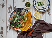 Colombian rucha al ajillo - river trout, served with a large, fried plantain, patacon and garlic sauce
