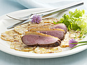 Seared duck breast on bread dumpling carpaccio