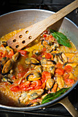 Saffron mussels with tomatoes and bay leaves