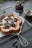 hazelnut giant financier cake with black currants