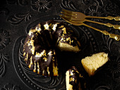 A mini Bundt cake with chocolate glaze and gold leaf