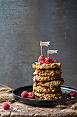 A stack of muesli cookies with raspberries