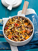 Spelt pasta with clams, cherry tomatoes and salsiccia