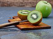 A halved kiwi on a wooden board