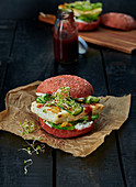 A beetroot burger with halloumi and ketchup
