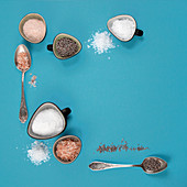 Different types of salt on blue background