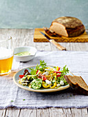 Summer salad with three kinds of cheese and beer bread