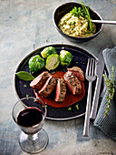 A saddle of venison à la minute with barley and herb risotto and brussels sprouts
