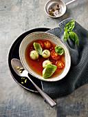 Clear tomato consommé with pistachio dumplings
