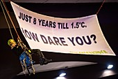 Child abseils with climate change protest banner, 2019