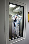 Donning biohazard protective clothing in laboratory airlock