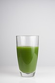 A glass of fresh green juice