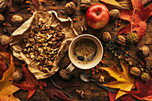 Apple,coffee and walnuts on table