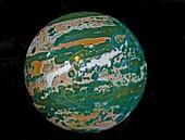 Polished sphere of ocean jasper
