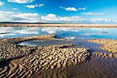 Wave marks on sand at low tide