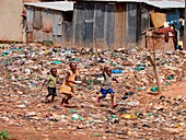 Children playing amongst refuse, Uganda