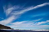 Cirrus spissatus clouds over a coastline in New Zealand