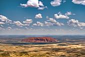 Uluru and cumulus humilis clouds