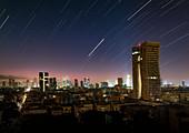Star trails and light pollution over Tel Aviv, Israel