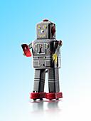 Retro robot texting on smartphone, composite image
