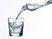 Sparkling water being poured into glass