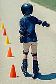 Boy learning to roller skate