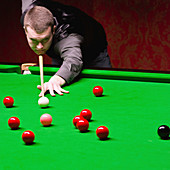 Snooker player taking a shot