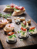 Various appetizers on wooden board