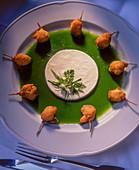 Breaded frog legs in herb sauce