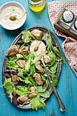 Veal with tuna sauce and salad