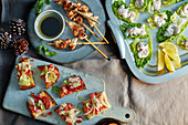 Sesame chicken skewers, bruschetta and prawn lettuce cups