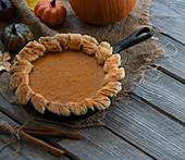 Homemade pumpkin pie baked in cast iron pan