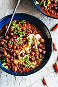 Smoky chilli con carne with crispy bambara groundnuts