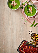 Cold pea soup with smoked shredded chicken, Barbecue pork ribs with baby marrow chips