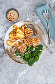 Pear and haloumi salad with spicy caramelised walnuts and poached pear vinaigrette