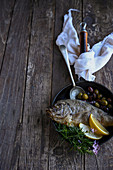 Whole roasted cape bream with olives and citrus
