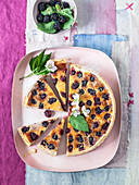 Blackberry tart (Clafoutis) with lime and coconut