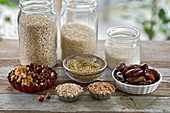 Vegan healthy baking ingredients in jars and bowls