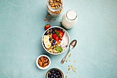Oat granola with fresh berries, banana, yogurt, chia seeds and mint leaves