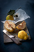 Quinces on a wooden board
