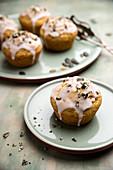 Vegan pumpkin cupcakes with icing and chopped pumpkin seeds